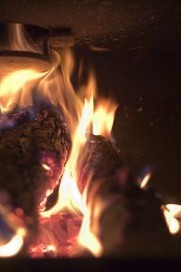 A fire in an iron fireplace